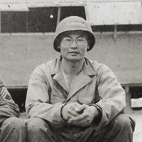Johnny Akimoto (On the right with the helmet), March, 1943. Akimoto Family Collection.